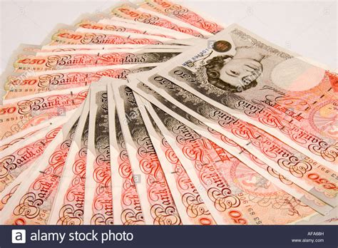A fan of five thousand pounds in new fifty pound notes